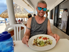 """Robby showing off his """"Huarache Azteca"""" meal"""
