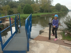 Abby operating the hand crank to open the lock gate; Canal du Nivernais