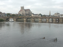 Cruising into Auxerre. Yes, the boat will fit under the bridge!