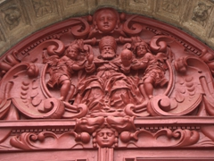 Close up of the carvings above the entrance to the Church of St. Pierre en Vallée; Auxerre