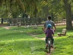 Tom and Abby riding through Bassou