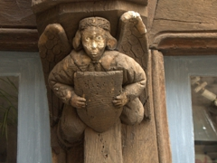 A carved angel on a half timbered house in Noyers-sur-Serein