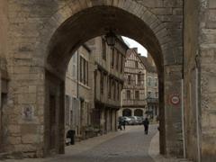 Imposing stone gateway to Noyers-sur-Serein