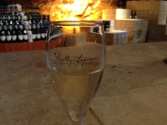 A free glass with a sample of crémant to conclude our tour of the immense limestone caves of Bailly