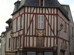 The clock is accurate twice a day; old half timbered house in Joigny
