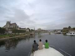 Freezing our bums off as we cruise into Auxerre
