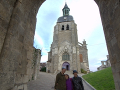 Becky, Abby and mom under the archway leading up to St. Jean Church; Joigny