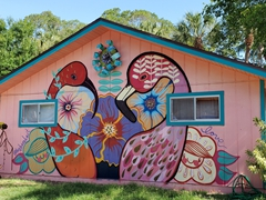 Painted mural on the side of a house; Village of the Arts