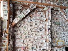 US dollars line the bar at Robbie's Marina; Islamorada