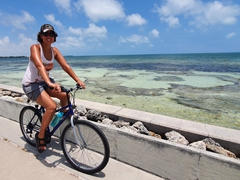 Becky biking to Key West from our campsite
