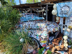 Old truck covered in stickers at B.O.'s Fish Wagon; Key West