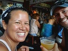 Enjoying beer and live music at Hog's Breath Saloon; Key West
