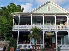 This seafood restaurant is in an 1884 house with wraparound balconies; Key West