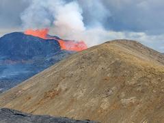 Lava spewing from Geldingadalir every few minuties - what a spectacular sight!