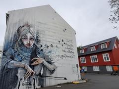 Girl with cello street art; Reykjavík