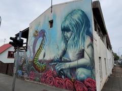 Girl playing with a caterpillar; Reykjavík
