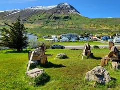 Wooden sculptures of three men chatting; Siglufjörður