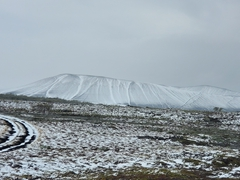 Snowy road leading to Hverfjall Crater