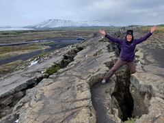 Becky standing in the lava crust fissure above Grjótagjá Cave