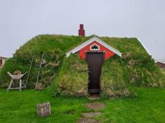 This cute red turf house called Lindarbakki is only inhabited during the summer months; Borgarfjörður eystri