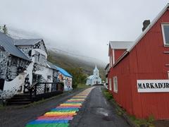 A rainbow colored street in Seyðisfjörður