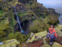 Becky posing next to her favorite waterfall in Iceland, Hangandifoss