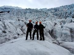 Three happy hikers (Marko, Becky and Robby); Falljökull glacier