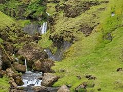 The pretty waterfall of Uxafótafoss on the outskirts of Vík í Mýrdal