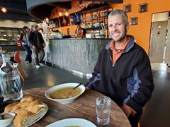 Robby enjoying Icelandic lamp soup at The Soup Company; Vík