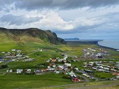 View of Vík í Mýrdal from a hill overlooking the town