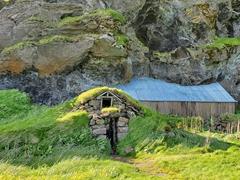 A house built into Drangurinn Rock