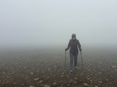 Becky trying to avoid stepping in mud; Fimmvörðuháls Trail in Þórsmörk
