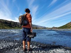 Robby contemplating wading across a glacial river in his tevas; Þórsmörk