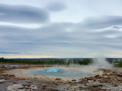 Strokkur geyser forming a bubble before erupting