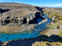 View of Sigöldugljúfur Canyon's vibrant blue water
