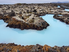 Just outside the Blue Lagoon, milky blue water flows through a 2000 year old lava field