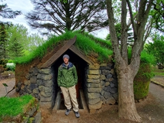 Robby at a turf house in the botanical garden; Reykjavik