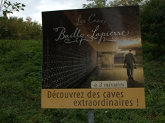 Billboard for Les Caves Bailly Lapierre, a limestone quarry used to store crémants