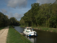 Mom patiently waiting for the lock keeper to arrive; near Accolay