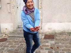Mom picking up chestnuts in Clamecy