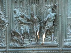 Detail of a Bronze statue of Christ (whose leg has been polished by countless tourists rubbing it); Duomo