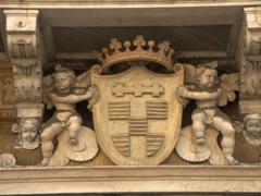 Cherub and crown crest; Via Garibaldi