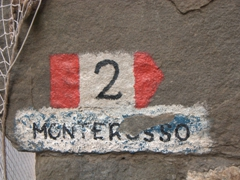 Hiking trail marker leading to Monterosso