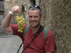 Robby smiles as he contemplates munching on these massive grapes; Corniglia