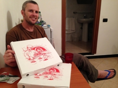Robby with our 7 Euro pepperoni pizza from Pizzeria Fratelli Basso; Vernazza