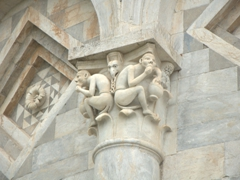 Monkey sculpture on the Leaning Tower of Pisa