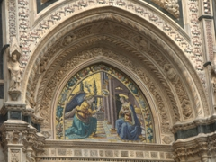 Detail of the Annunciation, a mosaic above the Porta della Mandorla, Duomo