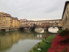 View of Ponte Vecchio, a medieval stone bridge spanning the Arno River at its narrowest point