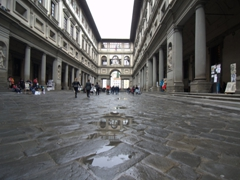 Puddle in the Uffizi Gallery courtyard after a rain storm
