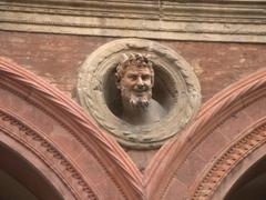Creepy, horned figurine on Palazzo Bolognini Amorini Salina; Piazza Santo Stefano